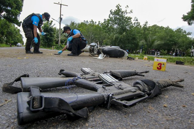 Forensic experts inspect the site of a bomb attack in the southern province of Pattani, Thailand, July 13, 2015.  Three soldiers were injured in the explosion, according to local media. (Photo by Surapan Boonthanom/Reuters)