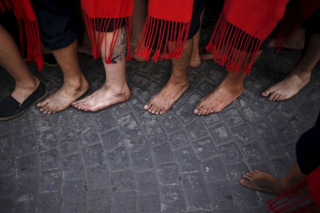 The feet of men in traditional costumes are seen as they carry a statue of the El Carmen Virgin on its way into the sea during a procession in Malaga July 16, 2015. (Photo by Jon Nazca/Reuters)