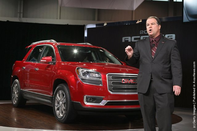 Tony DiSalle, U.S. Marketing Vice President at GMC, introduces the 2013 Acadia during the media preview of the Chicago Auto Show