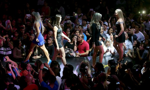 Competitors parade at the catwalk during the 2015 Brazil Miss and Mister Fitness contest in Sao Paulo, Brazil, June 18, 2015. (Photo by Paulo Whitaker/Reuters)