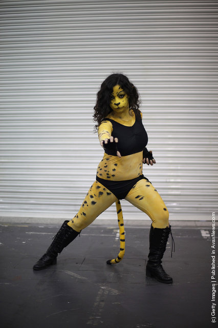 A visitor to the London Super Comic Convention dresses as Cheetah  at ExCel