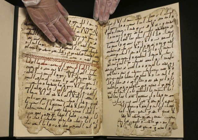 A fragment of a Koran manuscript is seen in the library at the University of Birmingham in Britain July 22, 2015. A British university said on Wednesday that fragments of a Koran manuscript found in its library were from one of the oldest surviving copies of the Islamic text in the world, possibly written by someone who might have known Prophet Mohammad. (Photo by Peter Nicholls/Reuters)