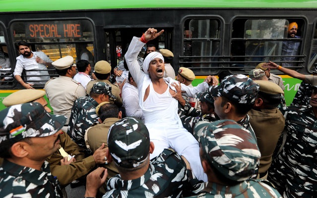 Indian youth congress workers shout anti-demonetisation slogans as they are detained by the police during a protest near the Reserve Bank of India (RBI) in New Delhi, India, 08 November 2019. Indian Youth Congress workers protested outside the RBI to highlight alleged issues facing the nation since last three years under the Modi regime after demonetisation, a news reports said. (Photo by Rajat Gupta/EPA/EFE)