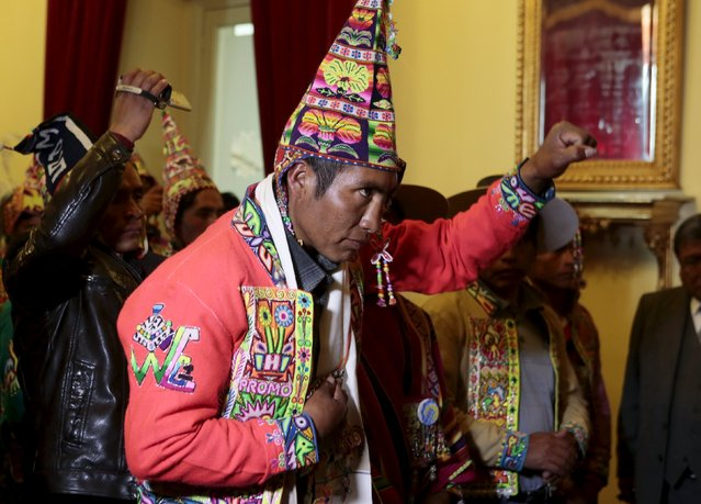 Felix Quispe swears in as the Presidential officer for communities in peace of Oruro Department at the presidential palace in La Paz, July 22, 2015. After the pacification of several Quechua communities of Oruro and Potosi due to differences in territorial limits, the government of President Evo Morales appointed a presidential representative to serve as the development of the region, according to local media. (Photo by David Mercado/Reuters)