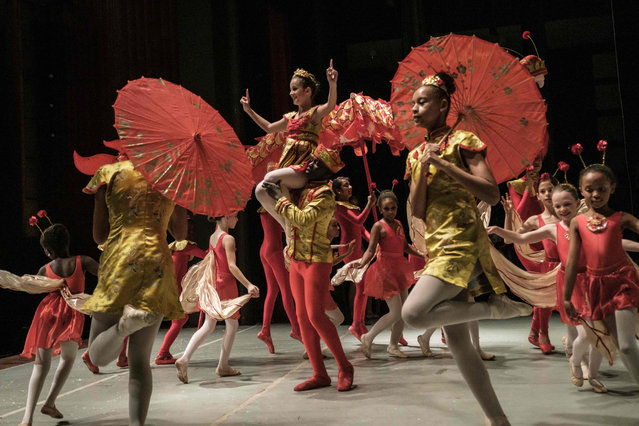 "Members of Dance Centre Kenya (DCK) perform during a production of the ""Nutcracker"", a ballet primarily performed during the Christmas period as their annual show, along with the Nairobi Philharmonic Orchestra with foreign guest musicians at the National Theater in Nairobi, on December 7, 2018. DCK, founded by a few passionate families in early 2015, teach over 700 students at 3 studios in Nairobi, and provides lessons based on the Royal Academy of Dance Syllabus. Selected students in various schools and slums receive scholarships to promote developing their talents. (Photo by Yasuyoshi Chiba/AFP Photo)"