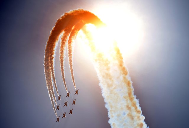 Britain's Red Arrows airplane display team perform during D-Day commemorations in Portsmouth in southern England on June 5, 2014. Several hundred surviving veterans of the 1944 D-Day landings are commemorating the 70th anniversary of the mission on both sides of the English channel. (Photo by Carl Court/AFP Photo)