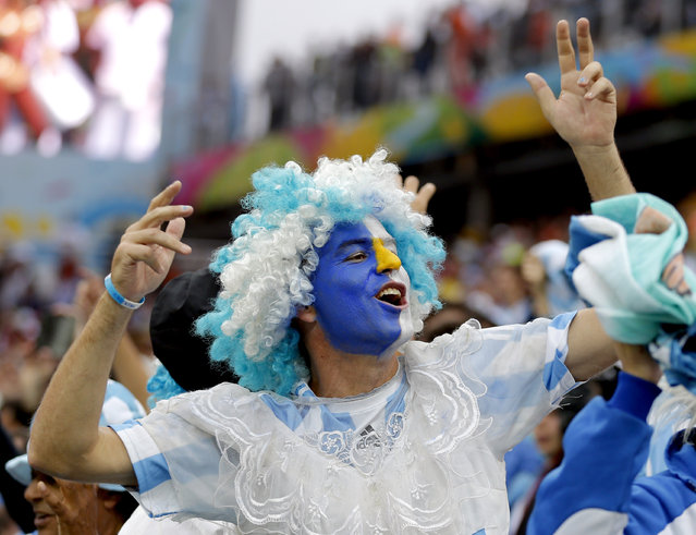 An Argentine supporter cheers before the World Cup semifinal soccer match between the Netherlands and Argentina at the Itaquerao Stadium in Sao Paulo Brazil, Wednesday, July 9, 2014. (pHOTO BY Victor R. Caivano/AP Photo)