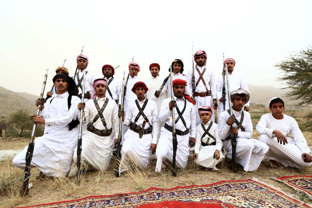 Men pose for a photo during a traditional excursion near the western Saudi city of Taif, August 8, 2015. (Photo by Mohamed Al Hwaity/Reuters)