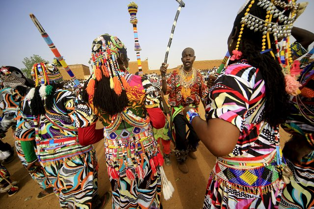 Traditional dancers from the Nuba Mountains tribe perform during a celebration of their cultural heritage, as part of ongoing events to commemorate the International Day of the World's Indigenous Peoples, in Omdurman August 15, 2015. (Photo by Mohamed Nureldin Abdallah/Reuters)