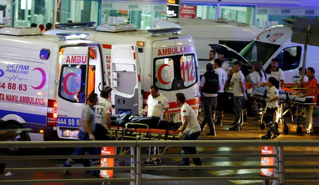 Paramedics push a stretcher at Turkey's largest airport, Istanbul Ataturk, Turkey, following a blast June 28, 2016. (Photo by Osman Orsal/Reuters)