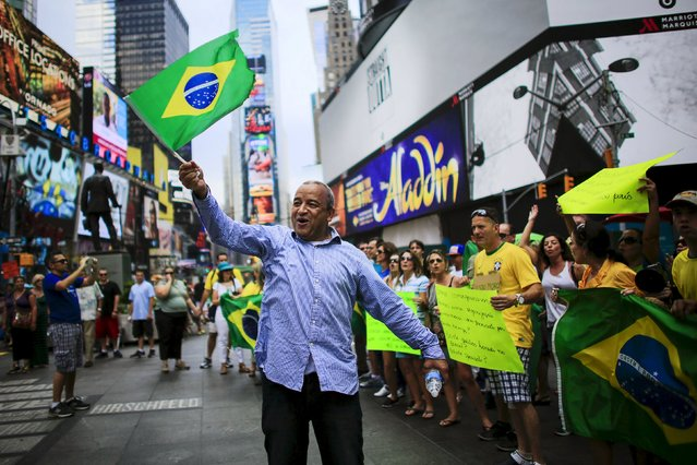 Demonstrators attend a protest against Brazil's President Dilma Rousseff at Times Square in New York August 16, 2015. (Photo by Eduardo Munoz/Reuters)