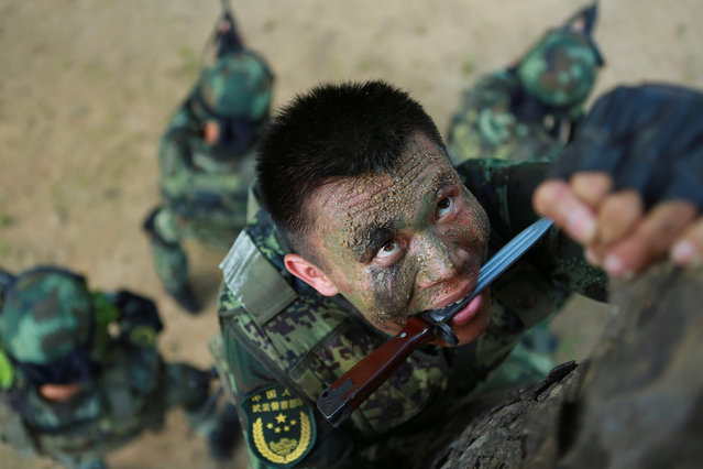 Paramilitary policemen take part in a summer training in Shenzhen, Guangdong province, China, June 27, 2016. (Photo by Reuters/China Daily)
