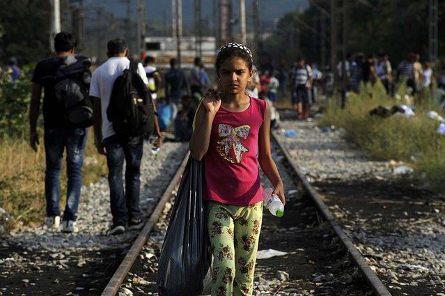 A migrant girl walks on the train tracks near the village of Idomeni at the Greek-Macedonian border, August 20, 2015. (Photo by Alexandros Avramidis/Reuters)