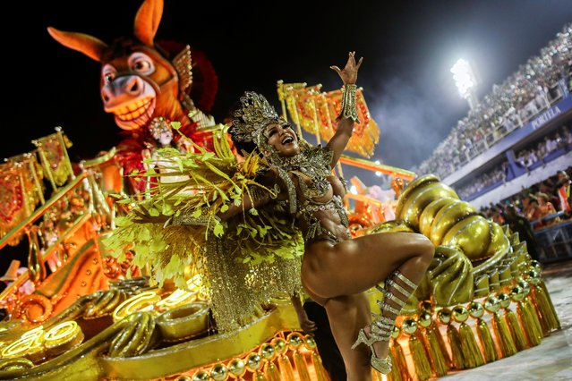 A member of Sao Clemente samba school performs during the second night of the Carnival parade at the Sambadrome in Rio de Janeiro, Brazil on February 24, 2020. (Photo by Ricardo Moraes/Reuters)
