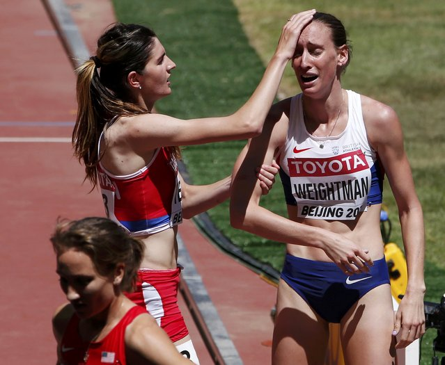 Amela Terzic of Serbia (L) consoles Laura Weightman of Britain (R) after the women's 1500 metres heats during the 15th IAAF World Championships at the National Stadium in Beijing, China August 22, 2015. (Photo by David Gray/Reuters)