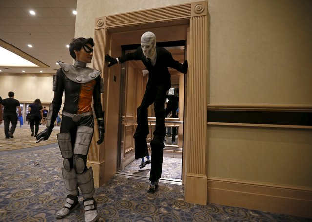 Attendees at Wizard World Comic Con step out of an elevator in Chicago, Illinois, United States, August 22, 2015. (Photo by Jim Young/Reuters)