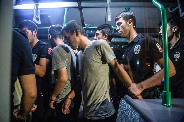 Turkish anti riot police officers detain Turkish soldiers who allegedly took part in a military coup as they are leaving in a bus the courthouse at Bakirkoy district in Istanbul on July 16, 2016. President Recep Tayyip Erdogan battled to regain control over Turkey on July 16, 2016 after a coup that claimed more than 250 lives, bid by discontented soldiers, as signs grew that the most serious challenge to his 13 years of dominant rule was faltering. (Photo by Ozan Kose/AFP Photo)