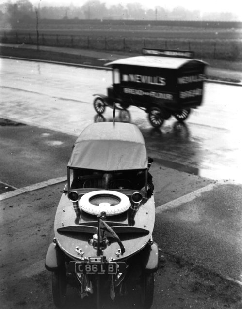 A Peugeot Motorboat Car, seen from above with a van passing behind it, October 1925.