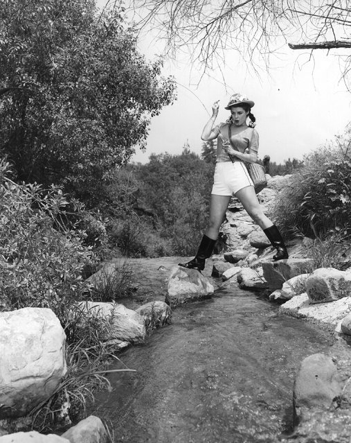 Pat Alphin, the Hollywood star and film actress catches a fish, circa 1935. (Photo by Hulton Archive)