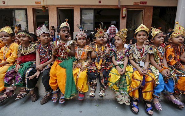 School children dressed as Hindu Lord Krishna, wait for their turn to perform during the celebrations on the eve of Janmashtami festival in Ahmedabad, India, September 4, 2015. (Photo by Amit Dave/Reuters)