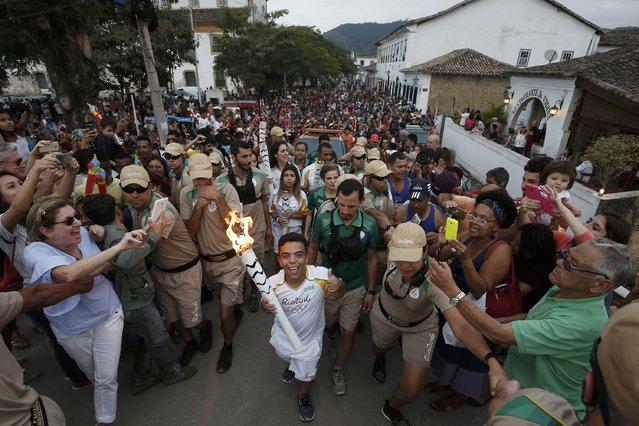2016 Rio Olympics, Olympic Torch Relay on July 29, 2016. Handout picture shows the Olympic torch as it is carried in Paraty. (Photo by Marcos de Paula/Reuters)