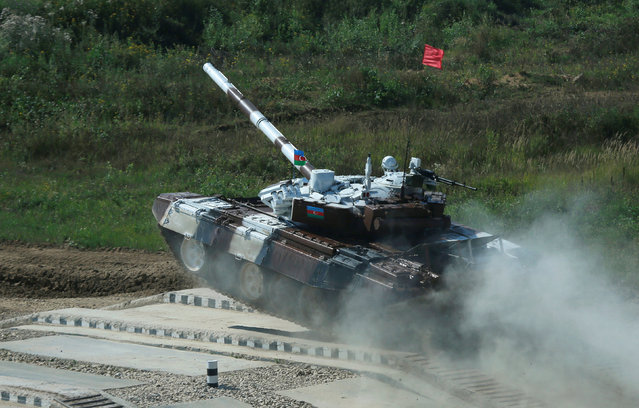 A T-72 tank, operated by a crew from Azerbaijan, drives during the Tank Biathlon competition, part of the International Army Games 2016, at a range in the settlement of Alabino outside Moscow, Russia, August 2, 2016. (Photo by Maxim Shemetov/Reuters)