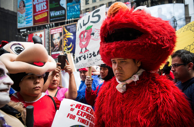 Costumed characters who work taking photos and collecting tips from people in Times Square hold a protest during a press conference announcing new legislation being introduced by city and state officials for the licensing and regulation of costumed people in Times Square on September 8, 2014 in New York City. As the number of costumed  characters has grown over the past year, a growing number of complaints and arrests of the characters have taken place. (Photo by Andrew Burton/Getty Images)