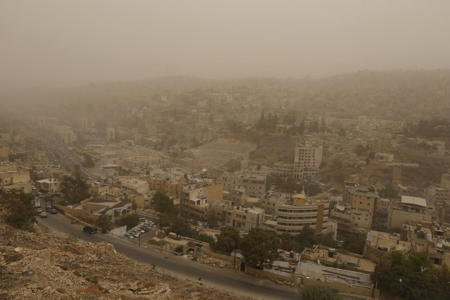 The Roman Amphitheatre (C) is seen during a sandstorm in downtown Amman, Jordan, September 8, 2015. (Photo by Muhammad Hamed/Reuters)