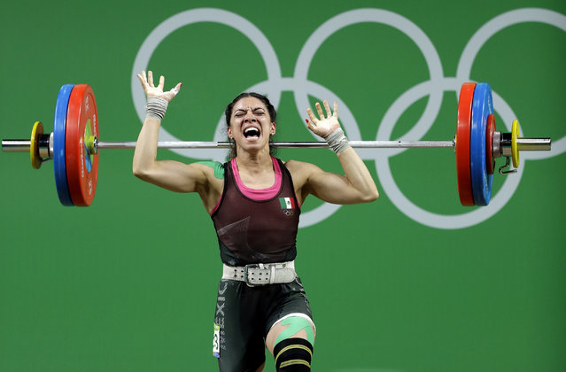 Monica Patricia Dominguez Lara, of Mexico, drops the barbell during an unsuccessful lift in the women's 58kg weightlifting competition at the 2016 Summer Olympics in Rio de Janeiro, Brazil, Monday, August 8, 2016. (Photo by Mike Groll/AP Photo)