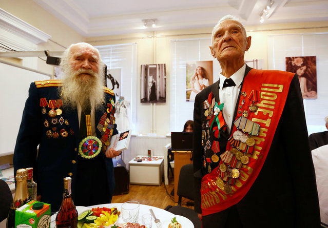 Belarussian World War II veterans Vasily Molodtsov (R) and Nikolay Skatulin pose for a photo during the event to mark the 71st anniversary of the country's liberation from Nazi Germany in Minsk, Belarus May 5, 2016. (Photo by Vasily Fedosenko/Reuters)
