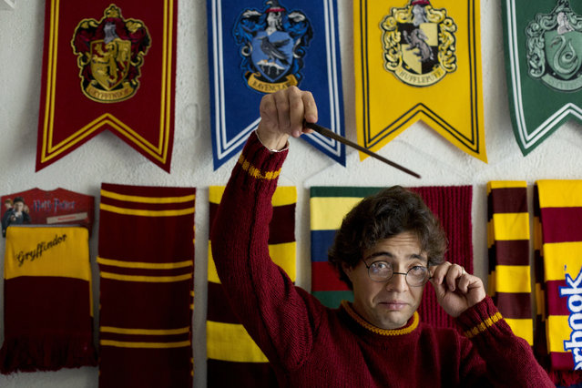 Menahem Asher Silva Vargas, a 37 year old lawyer, jokes around with a Harry Potter wand and glasses, during an interview at his home after receiving the Guinness World Record title for the largest collection of Harry Potter memorabilia, in Mexico City, Monday, September 29, 2014. Silva's 14 year old collection consists of more than 3000 individual items, including figurines, trading cards, wands, clothing, and accessories. (Photo by Rebecca Blackwell/AP Photo)
