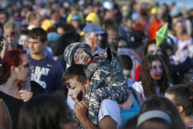 Young revellers take part in a Zombie Walk in Asbury Park, New Jersey October 4, 2014. (Photo by Eduardo Munoz/Reuters)
