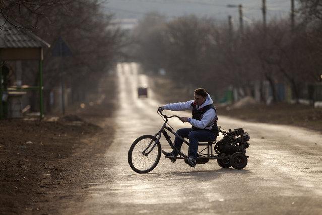 A man tests his handmade motorcycle in the Ivancea village, near Chisinau, Moldova, 04 March 2017. (Photo by Dumitru Doru/EPA)