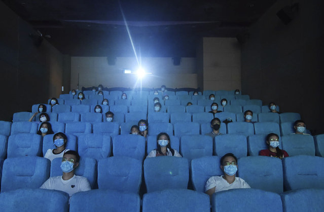 Movie-goers wearing masks to protect themselves from the coronavirus are spaced apart as they watch a movie in a newly reopened cinema in Hangzhou in eastern China's Zhejiang province on Monday, July 20, 2020. China is going back to the movies. Following months of closure, limited numbers of movie goers were allowed back Monday in cities where the risk of virus infection is considered low. (Photo by Chinatopix via AP Photo)