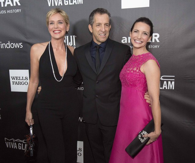 Fashion designer Kenneth Cole poses with actresses Sharon Stone (L) and Kristin Davis at amfAR's Fifth Annual Inspiration Gala in Los Angeles, California October 29, 2014. (Photo by Mario Anzuoni/Reuters)