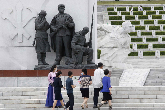North Koreans visit the Fatherland Liberation War Martyrs Cemetery to pay respects to the monument to the fallen soldiers of the Korean People's Army in Pyongyang, North Korea, Thursday, June 25, 2020. North and South Korea on Thursday marked the 70th anniversary of the start of the Korean War with largely subdued commemorations amid the coronavirus pandemic, a day after the North abruptly halted a pressure campaign against the South. (Photo by Jon Chol Jin/AP Photo)