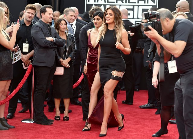 Kylie Jenner, left, and Khloe Kardashian arrive at the 42nd annual American Music Awards at Nokia Theatre L.A. Live on Sunday, November 23, 2014, in Los Angeles. (Photo by John Shearer/Invision/AP Photo)