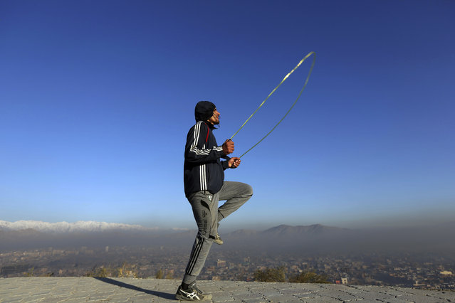 An Afghan youth exercises in the early morning on a hilltop in Kabul, Afghanistan, Wednesday, November 22, 2017. (Photo by Rahmat Gul/AP Photo)