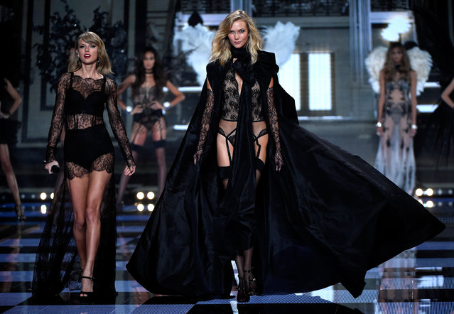Karlie Kloss walks the runway as Taylor Swift performs at the annual Victoria's Secret fashion show at Earls Court on December 2, 2014 in London, England. (Photo by Pascal Le Segretain/Getty Images)