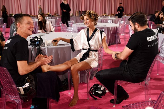 Victoria's Secret model Doutzen Kroes is pampered backstage before rehearsals for the 2014 Victoria's Secret Fashion Show in London, England, December 2, 2014. Photo by (Dimitrios Kambouris/Victoria's Secret)