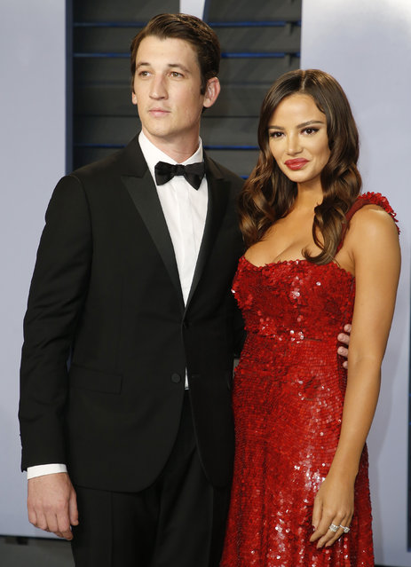 Miles Teller and actress Keleigh Sperry attend the 2018 Vanity Fair Oscar Party hosted by Radhika Jones at the Wallis Annenberg Center for the Performing Arts on March 4, 2018 in Beverly Hills, California. (Photo by Danny Moloshok/Reuters)
