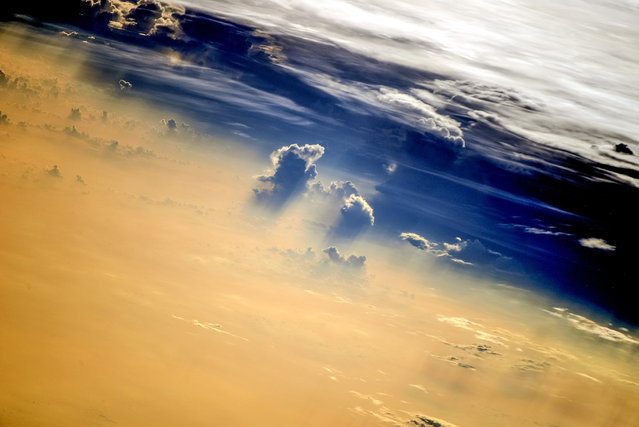 Image of the Clouds taken in August 2014 by astronauts on board the International Space Station (ISS).  A year from space photographs of hurricanes, typhoons and meteorite craters show an astronauts-eye view of our planet from hundreds of miles above the earth. The illuminating images were taken by astronauts onboard the International Space Station (ISS) over the course of 2014. (Photo by NASA/SPL/Barcroft Media)