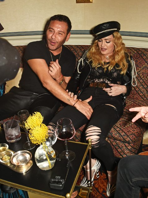 Mert Alas (L) and Madonna attend Edward Enninful's OBE dinner at Mark's Club on October 27, 2016 in London, England. (Photo by David M. Benett/Dave Benett/Getty Images for Edward Enninful)