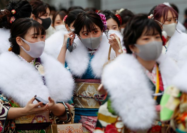 Kimono-clad youth wearing protective face masks leave their Coming of Age Day celebration ceremony at Yokohama Arena during the government declared the second state of emergency for the capital and some prefectures, amid the coronavirus disease (COVID-19) outbreak, in Yokohama, south of Tokyo, Japan on January 11, 2021. The ceremonies, typically full of kimono-clad women and smartly-dressed men, were canceled in many cities and parties were discouraged to stem a rise in COVID-19 infections. (Photo by Issei Kato/Reuters)