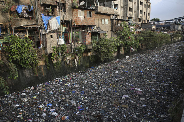 "Garbage chokes a polluted canal in Mumbai, India, Monday, June 4, 2018. The theme for this year's World Environment Day, marked on June 5, is ""Beat Plastic Pollution"". (Photo by Rafiq Maqbool/AP Photo)"