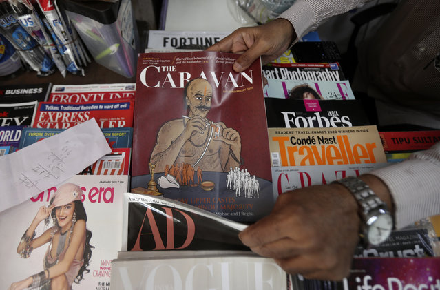 A vendor reaches out for a copy of The Caravan, India's leading investigating magazine, in Mumbai, India, Friday, February 5, 2021. When Vinod K. Jose, executive editor of the magazine logged onto Twitter on Monday, he was shocked to find the magazine's account blocked. Jose was already dealing with a case of sedition and other charges against him, the magazine owners and a freelance journalist. At the heart of the allegations is the magazine's coverage of the ongoing farmers' protests that have gripped India for more than two months. (Photo by AP Photo/Stringer)