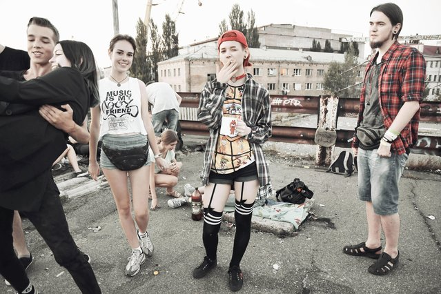 Youths during a party organised on a decommissioned bridge in Kiev. (Photo by Aude Osnowycz/The Guardian)