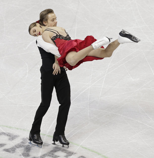 Kaitlin Hawayek and Jean-Luc Baker perform during the short dance program at the U.S. Figure Skating Championships in Greensboro, N.C., Friday, Jan. 23, 2015. (AP Photo/Chuck Burton)