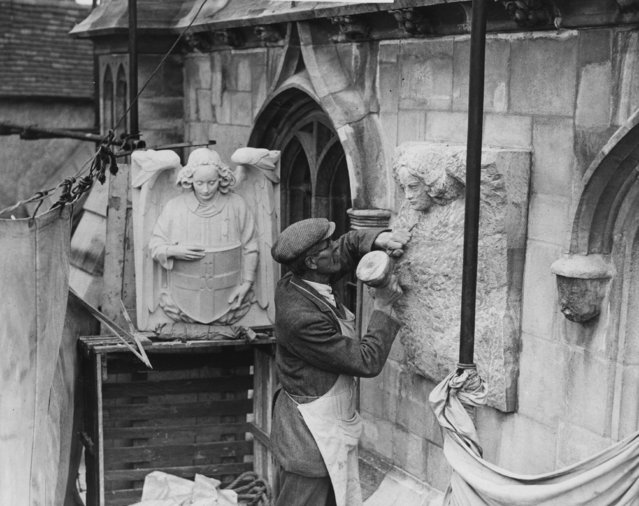 Making a stone copy from a plaster model of the original Coat of Arms of the Dean and Chapter during restoration work on Christ Church Gate at Canterbury Cathedral, Kent, 13th April 1934. (Photo by Reg Speller/Fox Photos/Getty Images)
