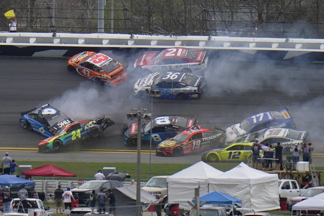 Cars collide on the 14th lap during the NASCAR Daytona 500 auto race at Daytona International Speedway, Sunday, February 14, 2021, in Daytona Beach, Fla. (Photo by Chris O'Meara/AP Photo)